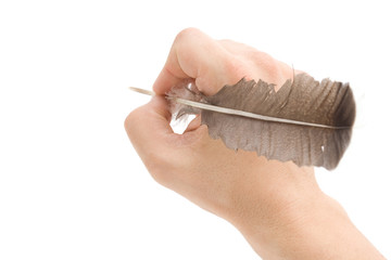 writing hand with pen feather