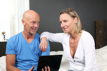 Adult couple at home discussing online services