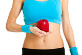 fitness woman holding a red apple