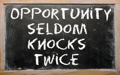 """Proverb """"Opportunity seldom knocks twice"""" written on a blackboar"""