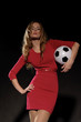 beautiful woman in dress with soccer ball