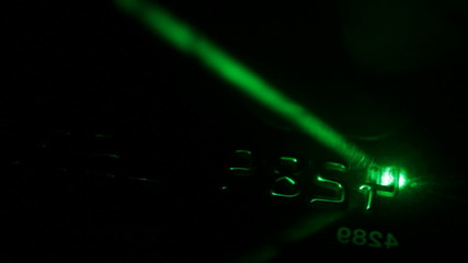 scanning credit card with green laser