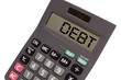 "Old calculator on white background showing text ""debt"" in perspe"