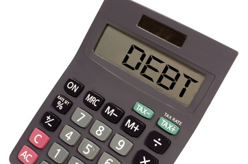 """Old calculator on white background showing text """"debt"""" in perspe"""