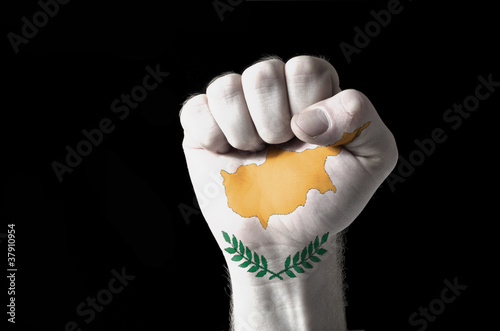 Fist painted in colors of cyprus flag