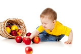 Funny child with basket filling apples