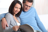 mature couple skimming through catalogue