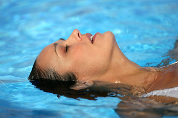 Woman laying in swimming pool