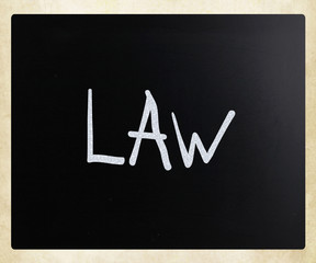 "The word ""Law"" handwritten with white chalk on a blackboard"