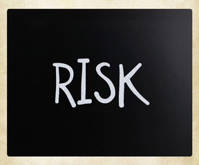 "The word ""Risk"" handwritten with white chalk on a blackboard"