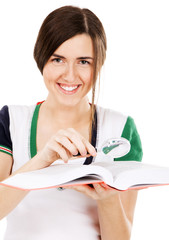 Young cute girl with a dictionary