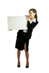 Woman in suit holding white panel
