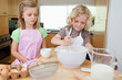 Young siblings preparing dough