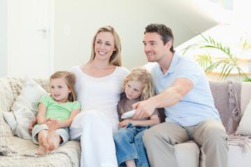 Happy family enjoying a movie