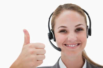 Smiling call center agent giving thumb up