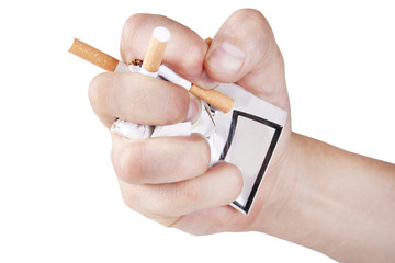 Man's hand crushing cigarettes on white background