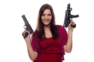 Young pretty woman with two guns