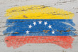 flag of venezuela on grunge wooden texture painted with chalk