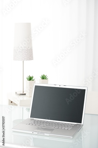 Laptop computer in bright room