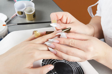 Manicure. Fastening of the disposable paper form