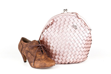 Pink bag with a shoe.