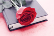 Red rose on a green book