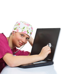 Female doctor examining laptop with stethoscope