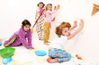 Children Clean Up After Food Fight at Pajama Party