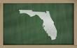 outline map of florida on blackboard