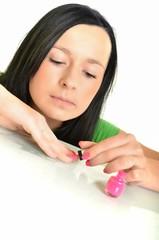woman painting nail