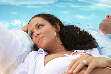 couple lying by the pool