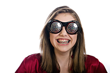 Teenager girl with braces and x-ray glasses