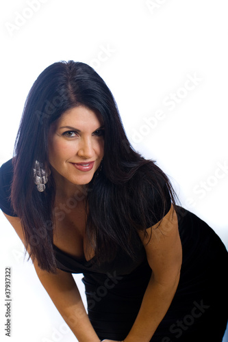sexy woman bent over with a coy expression