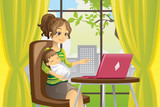 Fototapety Mother and baby using laptop