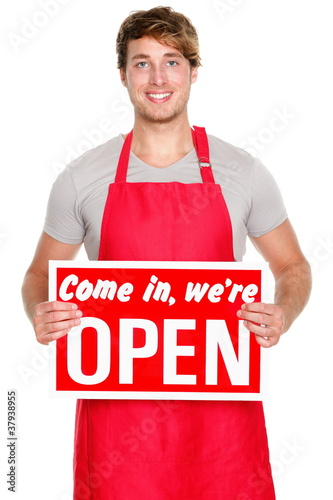 Business shop owner showing open sign