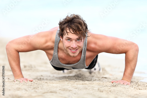 Fitness man exercising pushups