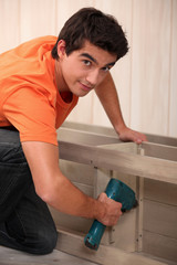 Young man making furniture