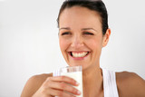 Cheerful woman drinking milk