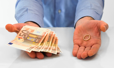 Man with wedding ring and money.