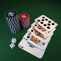 casino chips, dice, cards on the green cloth
