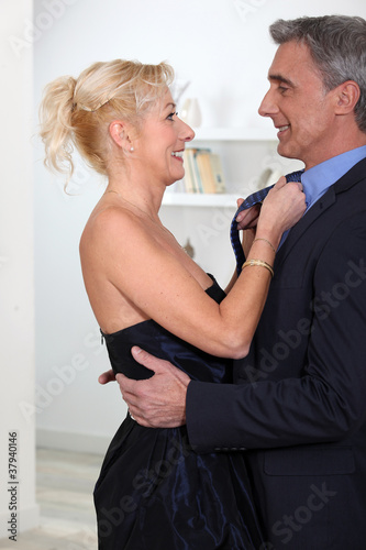 Woman fixing her husband's tie