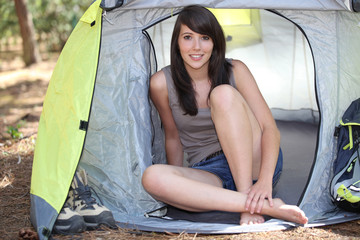 woman sat in tent
