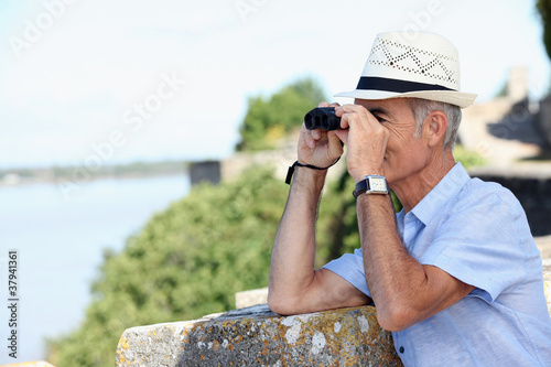 Old man with binoculars