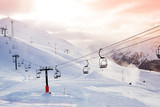 Winter mountains panorama with ski slopes and lifts
