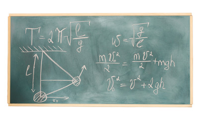formulas written on green chalkboard