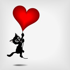 black kitty holding big red heart