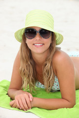 Pretty girl suntanning at the beach
