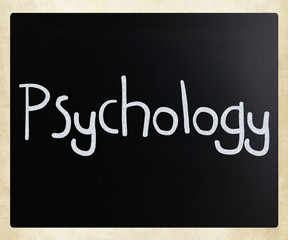 The word 'Psychology' handwritten with white chalk