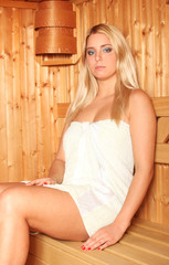 Beautiful blonde woman having sauna treatment