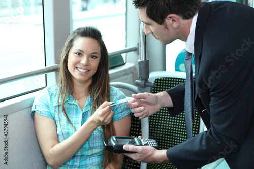 A young female passenger showing her card - 37945941